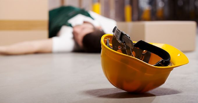 Worker laying on the floor